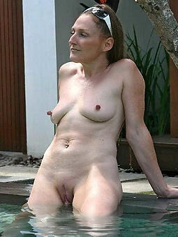 tiny mature blonde with huge tits