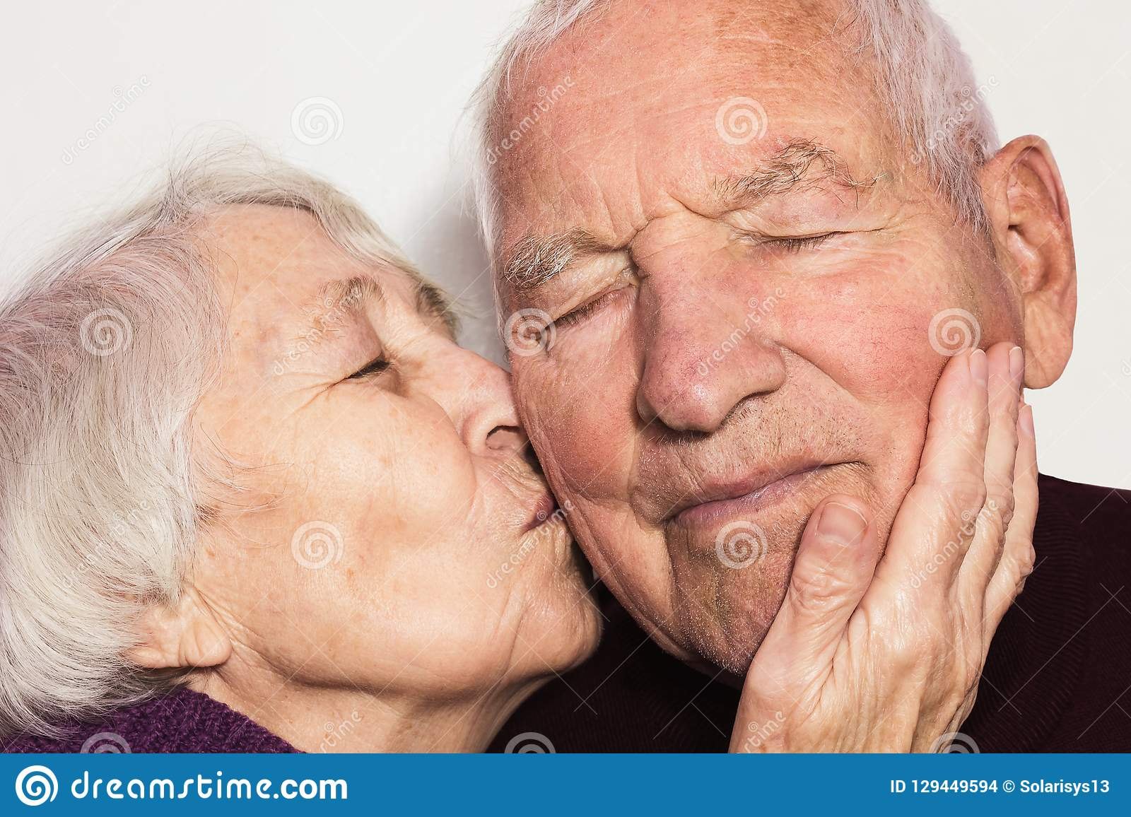 Loving and kissing an old man