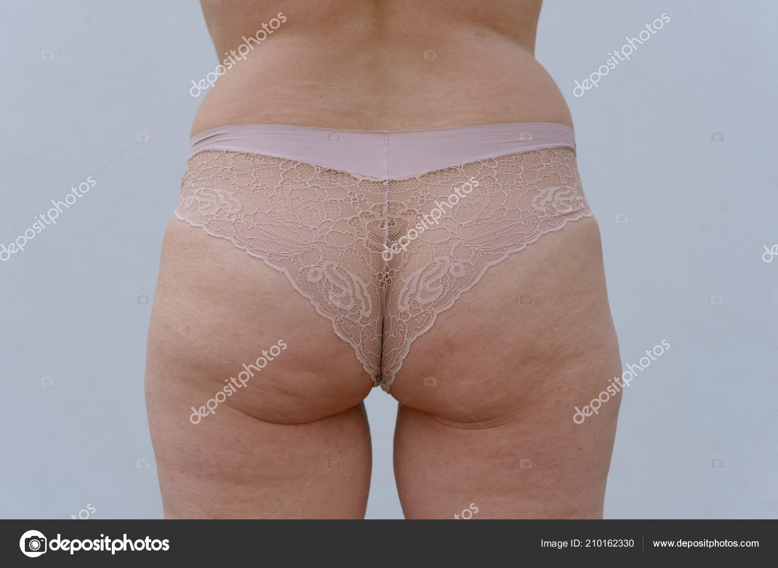 Middle aged womans buttocks
